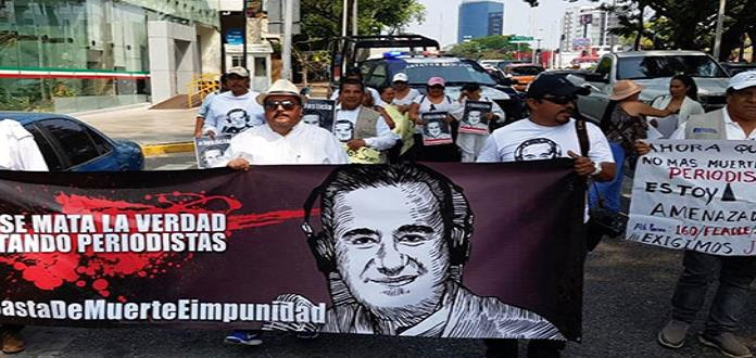 Con marcha, exigen justicia para periodista