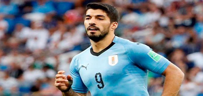 Suárez celebra 100 partidos, gol y clasificación de Uruguay