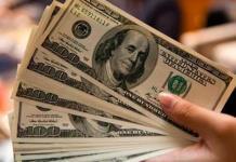 Dólar cierra en 19.69 pesos a la venta en bancos