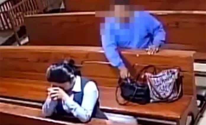 Un hombre se persigna tras robar dentro de iglesia (VIDEO)