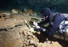 Hallan antigua mina de ocre en Yucatán, en cuevas submarinas
