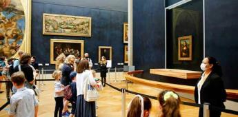 La Mona Lisa vuelve al trabajo en la reapertura del Louvre