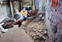 Arqueólogos localizan la fachada externa de la torre de cráneos de Tenochtitlan