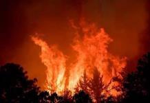 Lluvias favorecen control de incendio en sierra de Santiago, NL