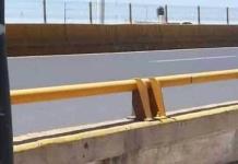 Policías rescatan a joven de lo alto de un puente en Salvador Nava