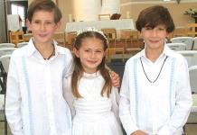José Luis, Covadonga y Diego reciben la comunión